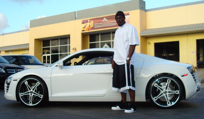 Here he is with his all white Audi R8 staggered on 22″ Forgiato wheels.